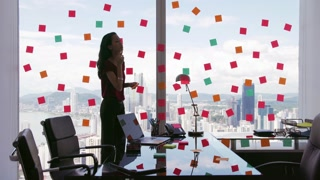 2 Business Person Attaching Sticky Notes On Large Window