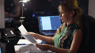 2 Businesswoman Working Late At Night With Tablet In Office