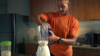 2 Man Athlete Prepares Protein Milk Shake In Kitchen