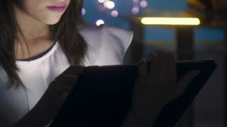 2 Young Student Using Tablet PC Indoor At Night
