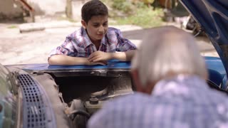 3-Boy With Grandpa Learning Car Engines From Senior Man