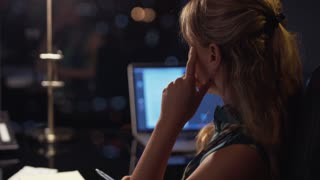 3 Businesswoman Working Late At Night With Bills In Office