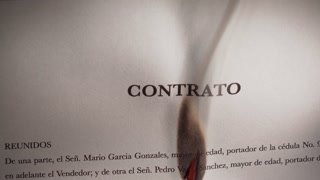 3 Closeup Of Contract In Spanish Burning On Fire