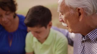 3-Grandparents Helping Child Doing School Homework
