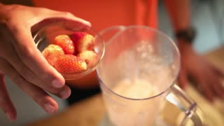 3 Man Prepares Protein Milk Shake With Strawberries