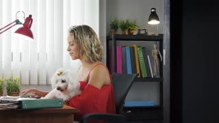 3-Office Woman Holding Dog During Skype Conference Call