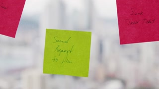 4 Business Person Attaching Sticky Notes On Large Window