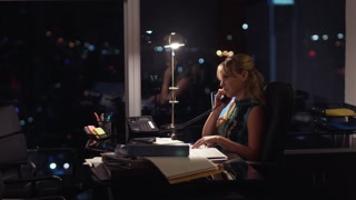 4 Businesswoman Working Late At Night Answering Phone Call