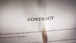 4 Closeup Of Contract In English Burning On Fire