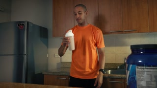 4 Man Athlete Drinks Protein Milk Shake After Training