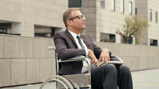 4of15 Health and handicap, business people on wheelchair outdoors