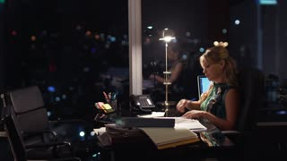 5 Businesswoman Working Late At Night Answering Phone Call