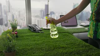 5 Ecologist Business Woman Watering Plants In Corporate Office