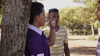5-Group Of Teenagers Boy Refusing To Smoke E-cig