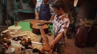 5-Lute Maker Grandpa Teaching Boy Grandson Tuning Guitar
