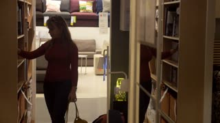 5of9 Young woman shopping for furniture and home decor