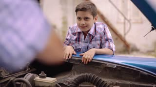 6-Boy Fixing Car Engine Gives Five To Grandpa