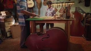 6-Lute Maker Grandpa Teaching Grandson Chiseling Wood
