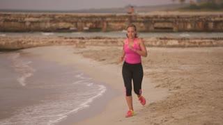 7-Active Girl Doing Fitness Running On Beach