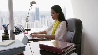 7 Business Woman Secretary Typing Fast On Laptop In Office