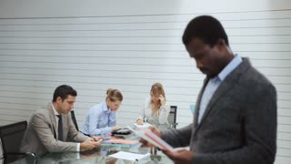 8of20 Team of business people working in office meeting room