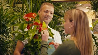 9of20 people in flower shop with florist and customer
