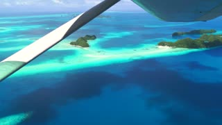 Aerial view of atolls and islands, Palau, Micronesia, Oceania, Pacific Ocean. Archipelago, tropical paradise seen from sky on airplane, plane flying over sea. Nature, landscape, travel, aircraft flight
