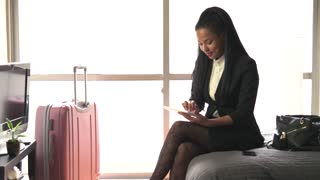 African American Black Woman Businesswoman With Ipad Tablet Hotel Room