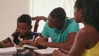 African American Family Mom Smiling Dad Helping Son With Homework