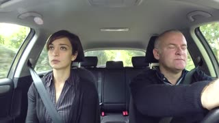 Angry Husband And Wife Having An Argument Traveling By Car