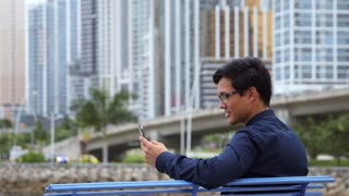 Asian businessman, chinese manager, man talking on mobile telephone