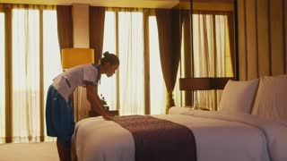 Asian housemaid cleaning hotel room, woman, people working. Girl in resort suite bedroom, setting up bed, staff, employee at work as housekeeper, professions, jobs