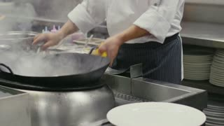 Asian restaurant, chinese chef cooking food, man as skilled, successful professional cook working in kitchen, professional occupation, job, people at work