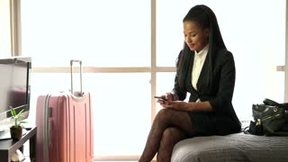 Black Businesswoman Talking On Phone In Hotel Room Business Travel