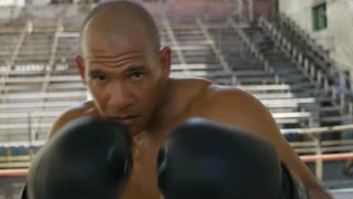 Black man exercising in boxing gym athlete boxe combat sports