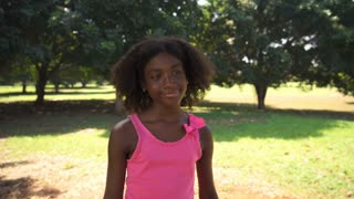 Black school girl hugging tree in park, ecology, people.mov
