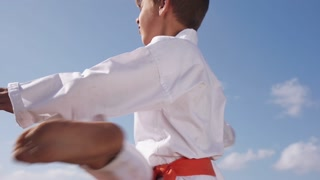 Boys Fighting At Karate School Children Practice Combat Sport