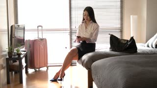 Business Travel Asian Woman Businesswoman With Smartphone In Hotel Room