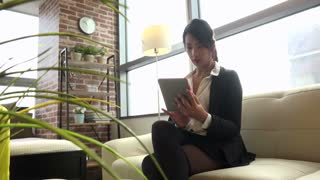 Business travel, people traveling, working in hotel room or at home, Korean female manager. Asian businesswoman, girl, woman at work, using ipad digital tablet, pc, computer for email, internet