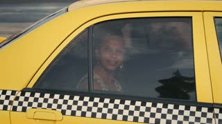 Business woman, tourist traveling by taxi, paying driver, money