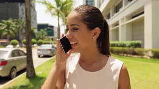 Business Woman With Headache Talking On Mobile Phone