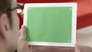 Businessman, man, manager using digital tablet pc, ipad with green screen for internet and email. People and technology