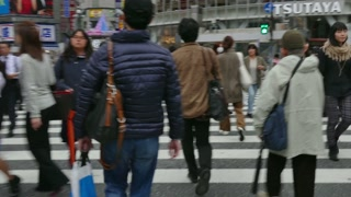 Busy people, pedestrians walking, crossing the street at rush hour. Shibuya district, Tokyo, Japan, Asia, one of the busiest intersections in the world. Crossroads, tourist spot