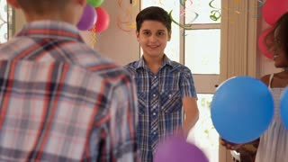 Cheerful Hispanic Boy Playing With Balloon And Having Fun