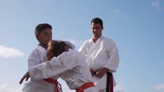 Children Fighting At Karate School With Teacher Slow Motion