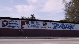 Cuba, La Habana, Havana, sign celebrating the revolution, cars, traffic