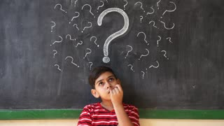 Doubts And Thoughts With Hispanic Child Thinking At School