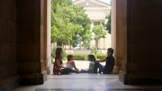Education and students in university, group of young men and women talking and relaxing in college, University of Havana, Cuba