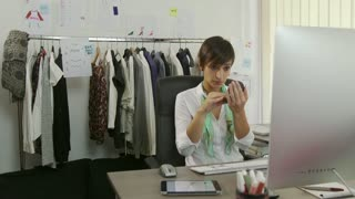 Female Beauty With Businesswoman Woman Manager Applying Make-up In Office