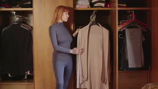 Girl Young Woman Trying Dress Clothes In Bedroom At Home